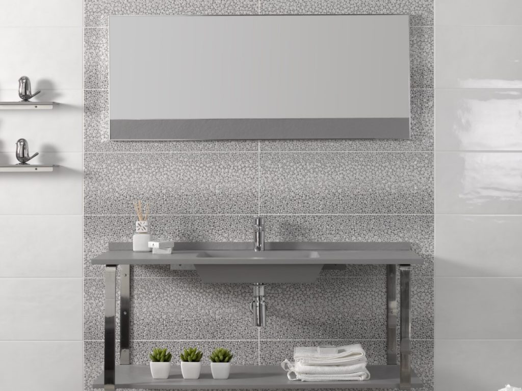 up to date bathroom with a think minimalist basin and unique grey decor tile