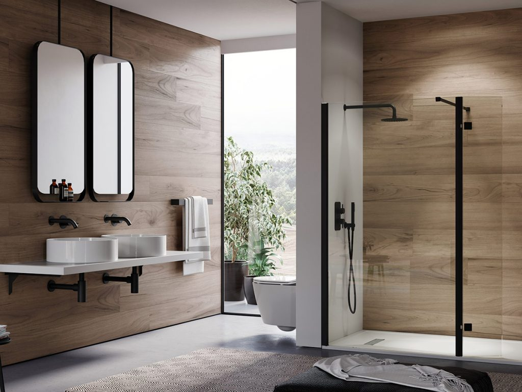 Saneux bathroom dislpay showing black taps, showers & shower enclosures