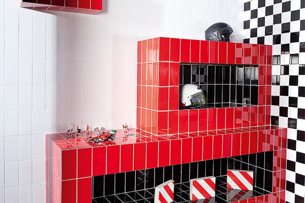 Red & Black metro tiles used to create a shelf for some F1 memorabilia