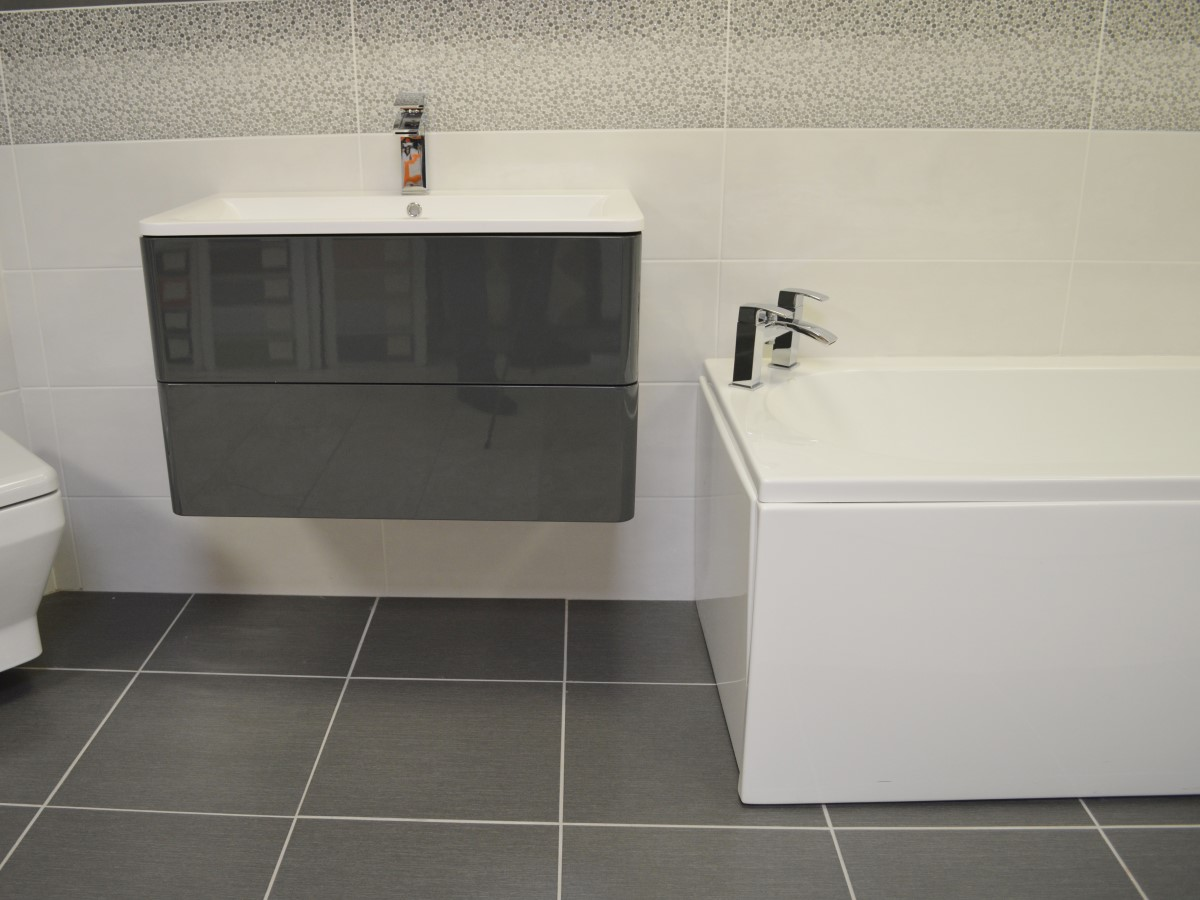 bathroom featuring a stand alone basin unit & grey floor tiles