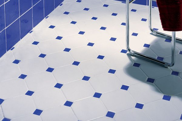 white and blue octagon floor tiles in a blue bathroom setting