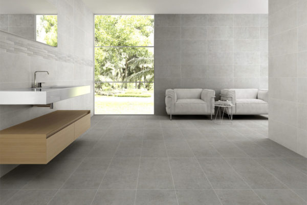 designer washroom with a large window and grey wall and floor tiles