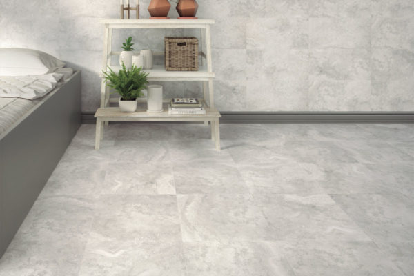 light grey, natural stone effect tiles in a bedroom setting