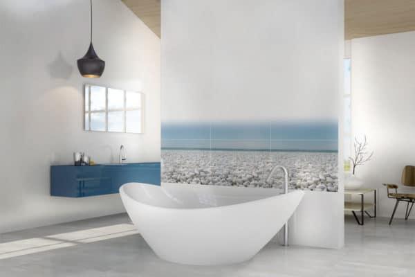 large freestanding bath in front of a tiled scene