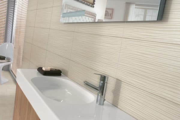 decorative tiled wall in bathroom with a basin & unit