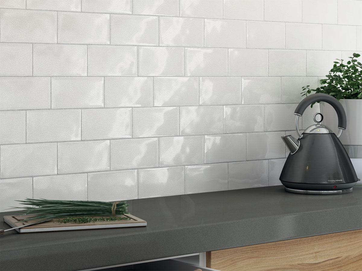contemporary kitchen with crackle glazed tiles as a splash back