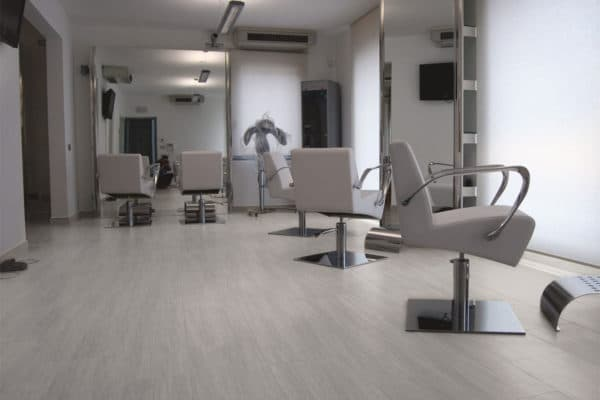 modern saloon with large mirros and white swivelling chairs