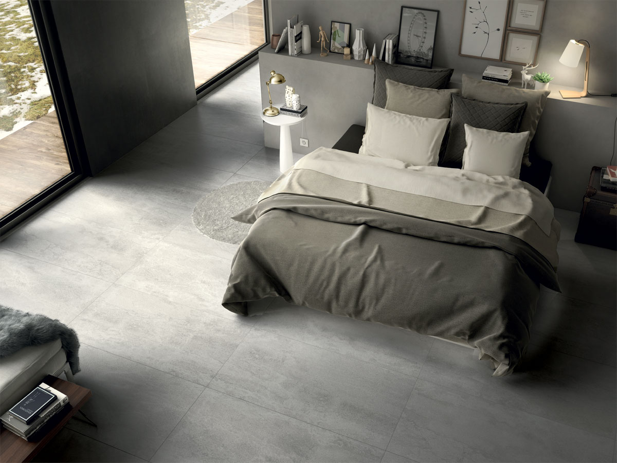 tiled master bedroom floor with a lush double bed