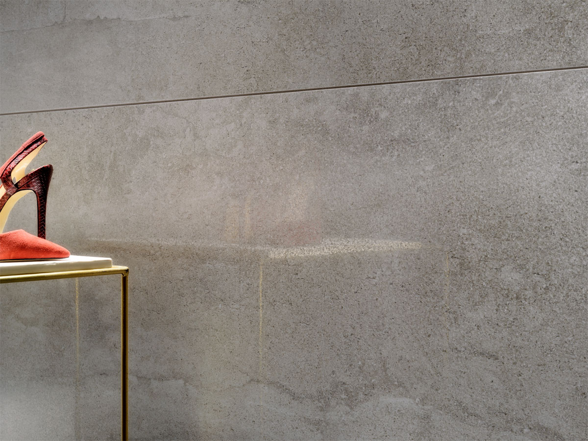close up of a grey tiled wall with a pleasing semi gloss finish