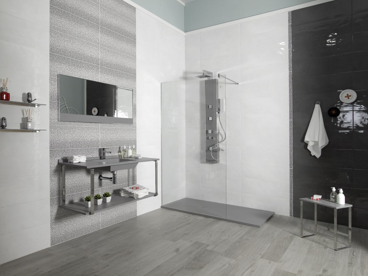 Modern walk in shower room with grey and white tiles