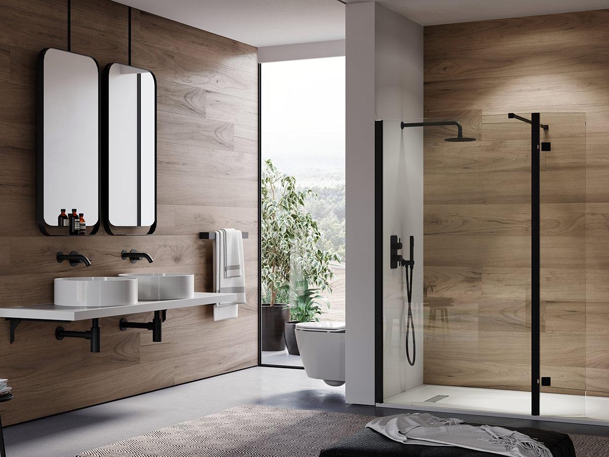 Saneux bathroom dislpay showing black taps, showers & shower enclosures