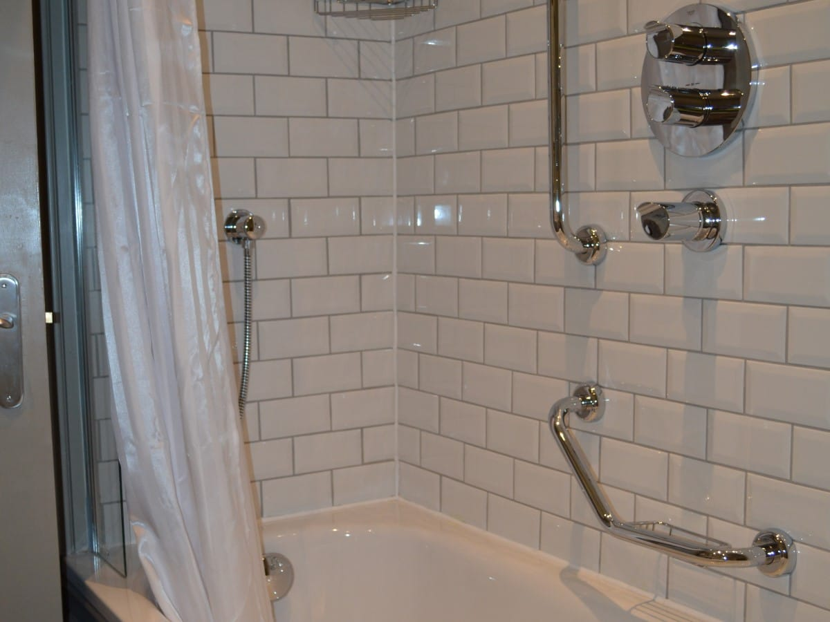 Bevel white metro tiles used inside a disability friendly shower