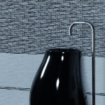 Unique basin and free standing tap design with black and white wall tiles
