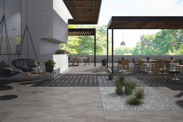 outside dinning & lounge area with a feature garden