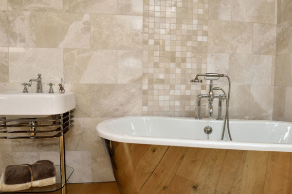 traditional bathroom with a freestanding bath & basin stand