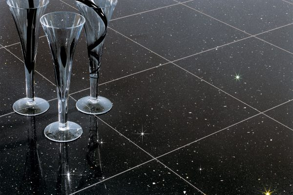 Elegant champagne flutes on a crystal tiled floor