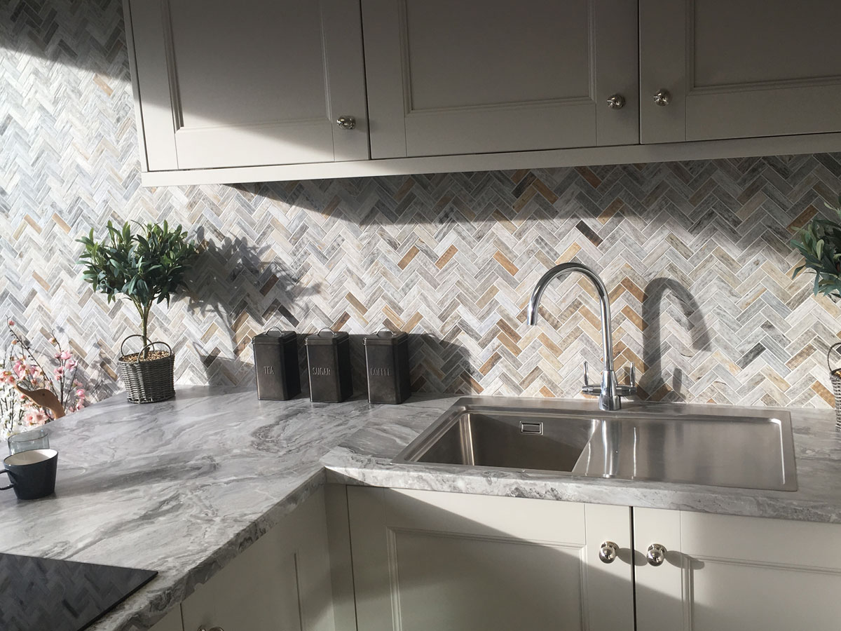 stylish kitchen with herringbone wood effect splash back