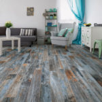 Unique blue coloured wood effect flooring in a contemporary living room