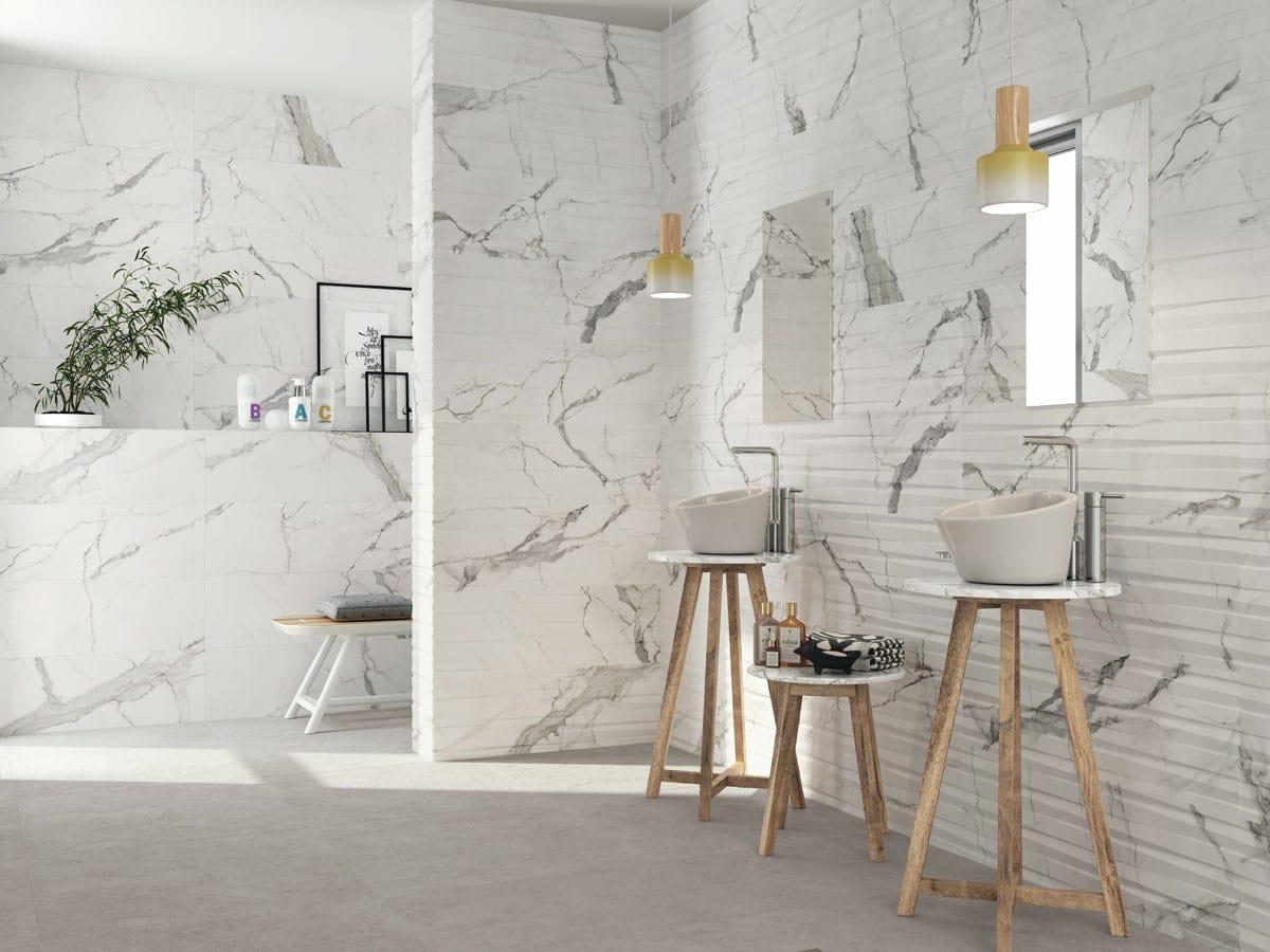 matt marble effect wall tiles and decor tiles in a modern bathroom