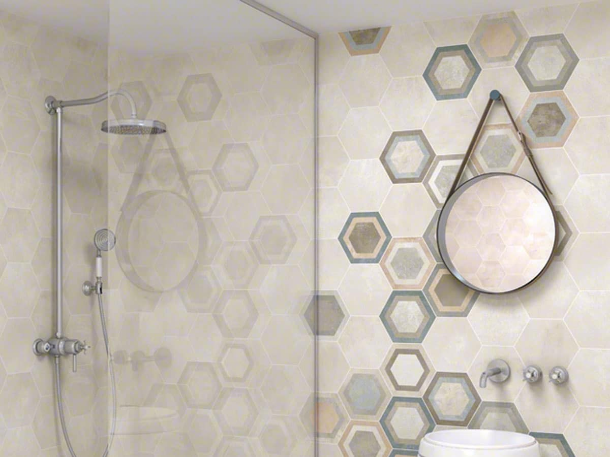 mixture of patterned and plain hexagon wall tiles in a modern shower room setting